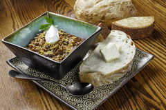 Rustic bowl of chili with bread and cheese Stock Images