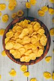 Rustic bowl of corn flakes royalty free stock images