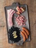 Rustic brazilian feijoada pork and black bean stew ingredient Stock Photos
