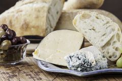 Rustic bread with assorted cheeses Royalty Free Stock Photo