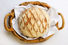 Rustic bread in bakery basket. Rustic bread in the bakery basket with napkin Royalty Free Stock Images