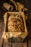 Rustic bread in baking tin and wheat on vintage wood table Royalty Free Stock Photos
