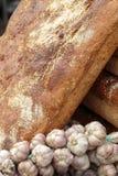 Rustic bread and bulbs of fresh garlic Royalty Free Stock Photos