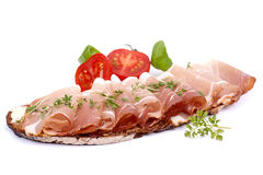 Rustic bread with cured ham Royalty Free Stock Photo