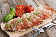 Rustic bread with cured ham Royalty Free Stock Images