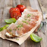 Rustic bread with cured ham Royalty Free Stock Photography