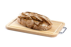 Rustic bread on cutting board isolated Royalty Free Stock Photos