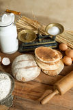 Rustic bread and eggs. Rustic still life of vintage scales, bread, wheat, eggs and rolling pin Royalty Free Stock Photography