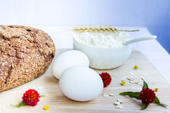 Rustic bread, eggs and flour Royalty Free Stock Photo