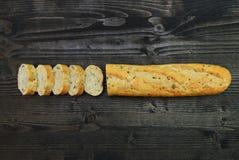 Rustic bread over dark wood Stock Photos