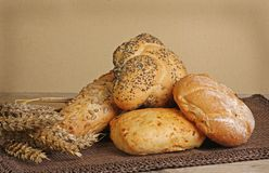 Rustic bread rolls. Selection of rustic bread on a wooden table Stock Photos