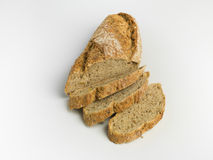 Rustic bread with seeds. Sliced rustic bread  isolated against white background Royalty Free Stock Photo