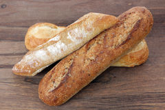 Rustic bread. Some kind of rustic bread on rustic table Royalty Free Stock Images