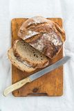 Rustic bread. Rustic sourdough bread and knife Stock Photography
