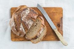 Rustic bread. Rustic sourdough bread and knife stock photo