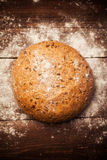 Rustic bread on table Stock Image