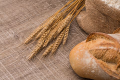 Rustic bread and wheat Royalty Free Stock Photos