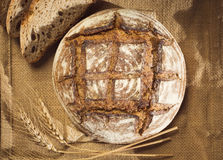 Rustic bread and wheat on a traditional cloth Stock Photo