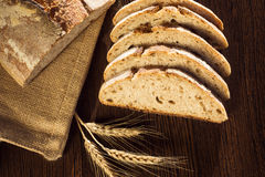 Rustic bread and wheat on a traditional cloth Royalty Free Stock Images