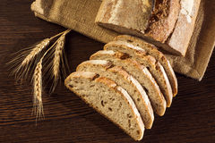 Rustic bread and wheat on a traditional cloth Royalty Free Stock Photo