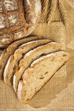 Rustic bread and wheat on a traditional cloth Royalty Free Stock Photography