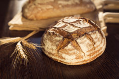 Rustic bread and wheat on a traditional cloth bag Stock Image
