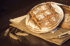 Rustic bread and wheat on a traditional cloth bag Stock Photos