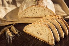 Rustic bread and wheat on a traditional cloth bag Royalty Free Stock Photos