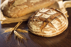 Rustic bread and wheat on a traditional cloth bag Stock Photography