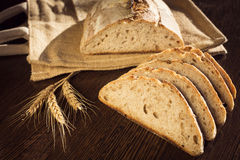 Rustic bread and wheat on a traditional cloth bag Royalty Free Stock Photo