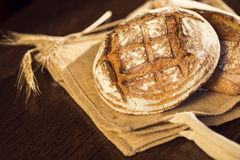 Rustic bread and wheat on a traditional cloth bag Royalty Free Stock Images