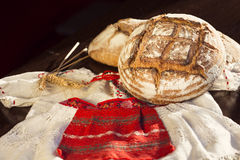 Rustic bread and wheat on a traditional girl costume Stock Photo