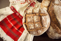 Rustic bread and wheat on a traditional girl costume Stock Photos