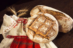 Rustic bread and wheat on a traditional girl costume Royalty Free Stock Photography