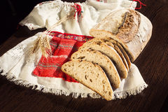 Rustic bread and wheat on a traditional girl costume Royalty Free Stock Photos
