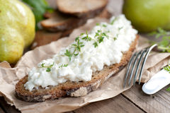 Rustic bread with white cheese Stock Images