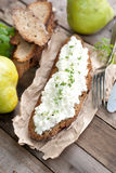 Rustic bread with white cheese Royalty Free Stock Images