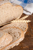 Rustic bread on wood Royalty Free Stock Photos