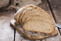 Rustic Bread on wooden background Royalty Free Stock Photos
