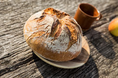 Rustic bread on wooden table Stock Images