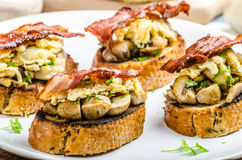 Rustic breakfast - bread toast, mushrooms, eggs Stock Photo