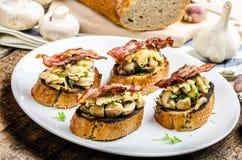 Rustic breakfast - bread toast, mushrooms, eggs Stock Photography