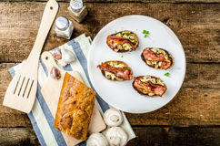 Rustic breakfast - bread toast, mushrooms, eggs Royalty Free Stock Image