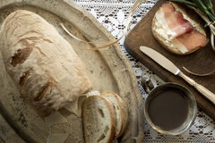 Rustic breakfast - cup of tea and slice of bread with ham. Rustic breakfast - cup of tea and slice of bread Royalty Free Stock Images