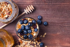 Rustic breakfast with granola and honey Stock Images