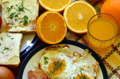 Rustic breakfast - roasted bread with butter and chives, fried eggs and bacon Stock Images