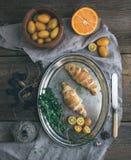 Rustic breakfast set. Chocolate croissants on metal dish, fresh Stock Image