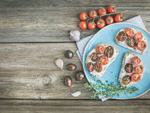 Rustic breakfast set of sandwiches with soft cream-cheese, cherr Royalty Free Stock Images