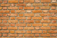Rustic red brick wall. A close up of a wall made of rustic red bricks and mortar stock photo