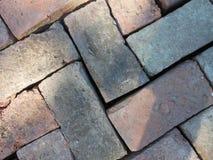 Rustic brick background in a herringbone pattern Stock Photo
